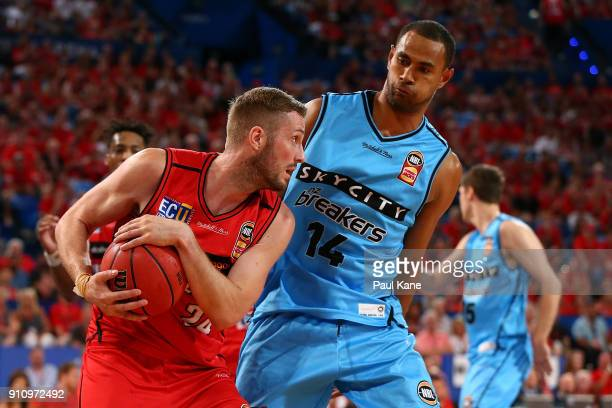 Jesse Wagstaff of the Wildcats holds the ball off Mika Vukona of the Breakers during the round 16 NBL match between the Perth Wildcats and the New...