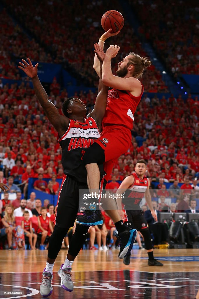 Jesse Wagstaff of the Wildcats lays up against Marvelle Harris of the Hawks during game three of the NBL Grand Final series between the Perth Wildcats and the Illawarra Hawks at Perth Arena on March 5, 2017 in Perth, Australia.