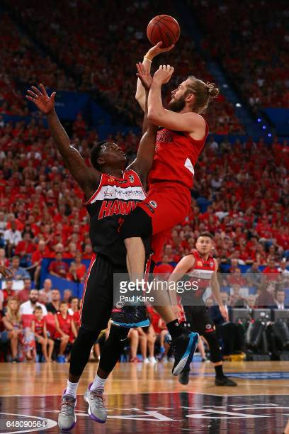 Jesse Wagstaff of the Wildcats lays up against Marvelle Harris of the Hawks during game three of the NBL Grand Final series between the Perth...