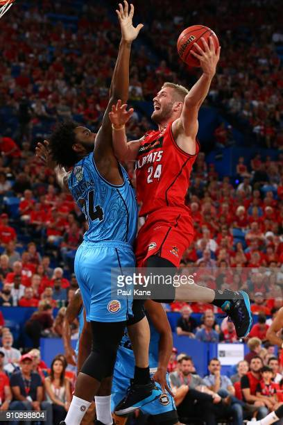 Jesse Wagstaff of the Wildcats lays up against Rakeem Christmas of the Breakers during the round 16 NBL match between the Perth Wildcats and the New...