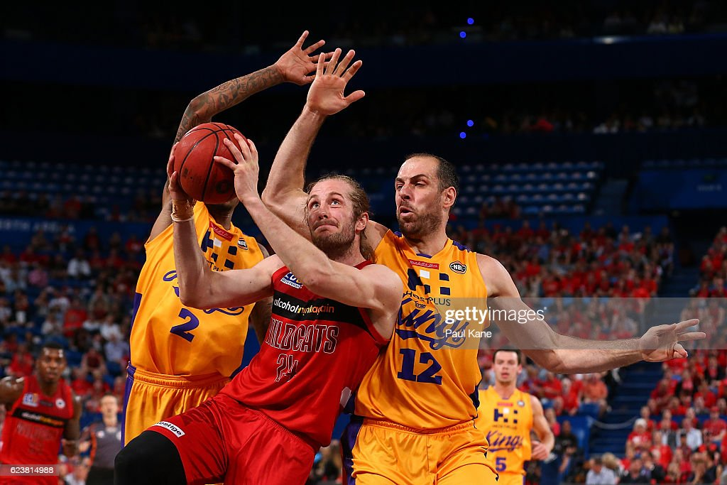 Jesse Wagstaff of the Wildcats laysup against Greg Whittington and Aleks Maric of the Kings of the Kings during the round seven NBL match between the Perth Wildcats and the Sydney Kings at Perth Arena on November 17, 2016 in Perth, Australia.