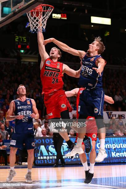 Jesse Wagstaff of the Wildcats looks to block a shot by Anthony Drmic of the 36ers during game one of the Semi Final series between the Adelaide...
