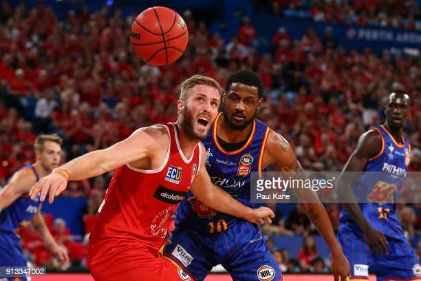 Jesse Wagstaff of the Wildcats looks to take posession of a loose ball against Ramone Moore of the 36ers during the round 17 NBL match between the...
