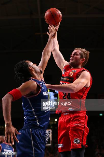 Jesse Wagstaff of the Wildcats puts a shot up against Josh Childress of the 36ers during game one of the Semi Final series between the Adelaide 36ers...