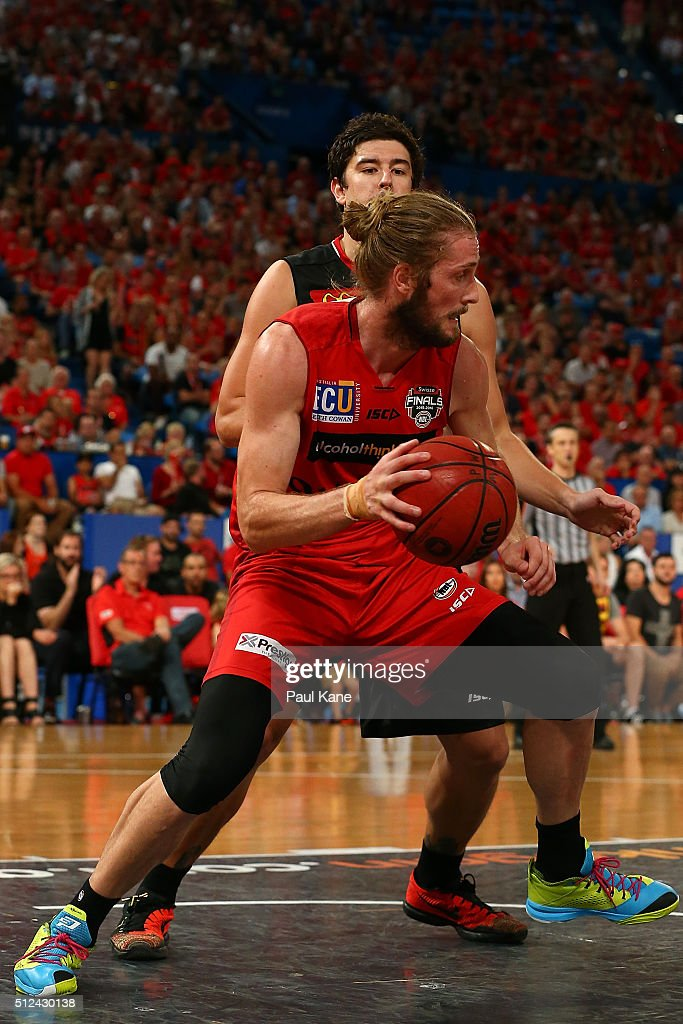 Jesse Wagstaff of the Wildcats works the ball against Cody Ellis of the Hawks during the NBL Semi Final match between Perth Wildcats and Illawarra Hawks at Perth Arena on February 26, 2016 in Perth, Australia.
