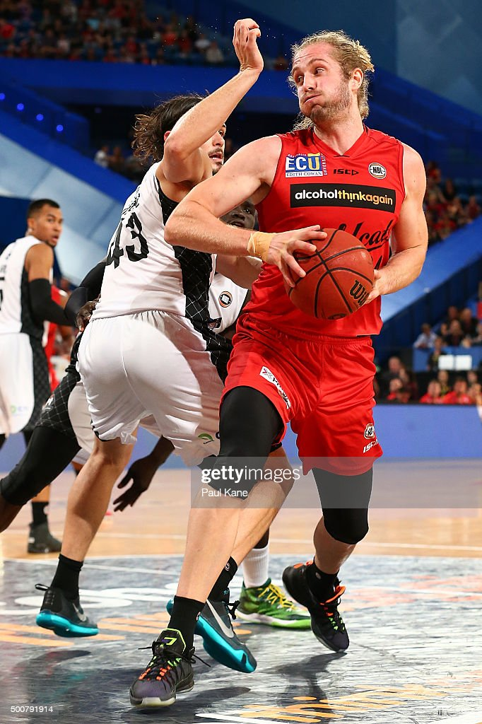 Jesse Wagstaff of the Wildcats works to the basket against Chris Goulding of United during the round 10 NBL match between the Perth Wildcats and Melbourne United at Perth Arena on December 10, 2015 in Perth, Australia.