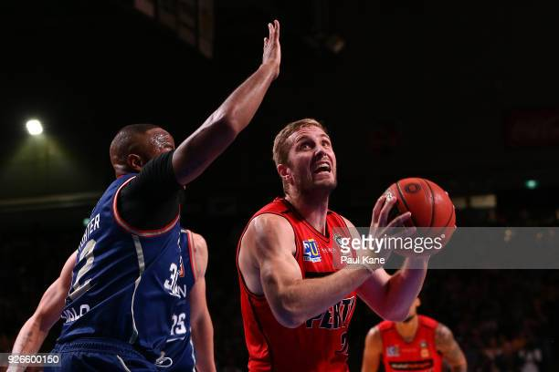 Jesse Wagstaff of the Wildcats works to the basket against Shannon Shorter of the 36ers during game one of the Semi Final series between the Adelaide...