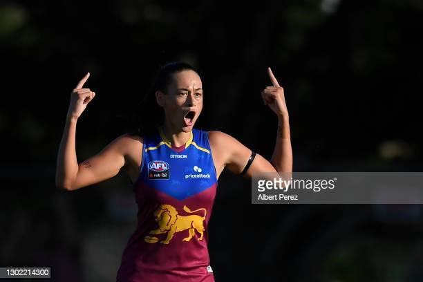 Jesse Wardlaw of the Lions celebrates with team mates after scoring a goal during the round three AFLW match between the Brisbane Lions and the West...