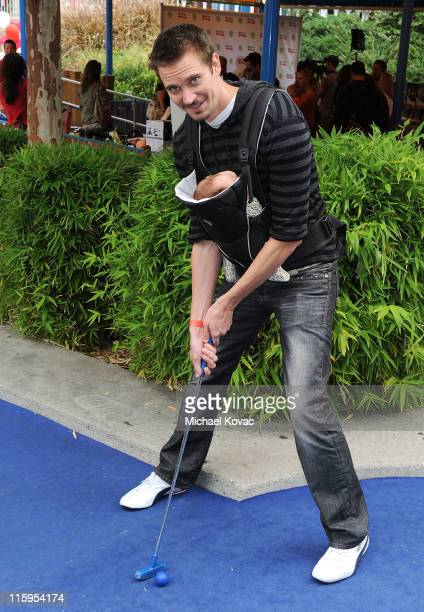 Jesse Warren and his son Finn attends Britax and Baby Buggy host PreFather's Day Mini Golf Open to Celebrate the summer launch of The Britax Baby...
