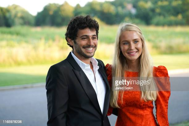 Jesse Warren and Martyna Sokol attend the Annual Summer Party Benefiting Stony Brook Southampton Hospital on August 03, 2019 in Southampton, New York.
