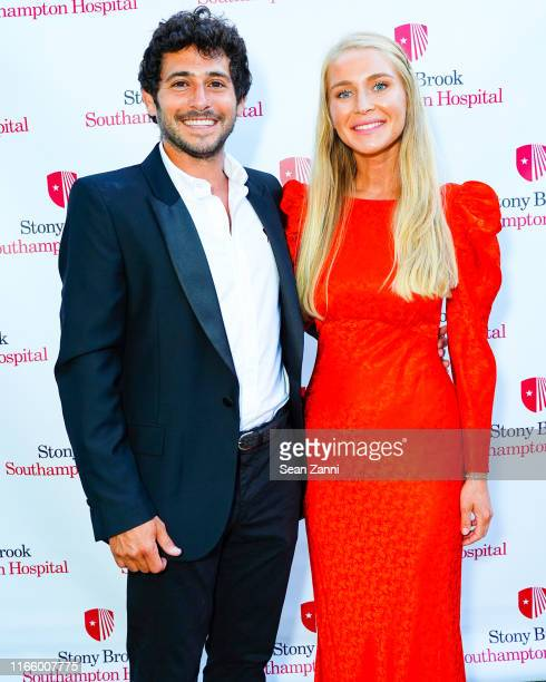 Jesse Warren and Martyna Sokol attend the Annual Summer Party Benefiting Stony Brook Southampton Hospital on August 03 2019 in Southampton New York