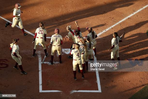 Jesse Warren of the Florida State Seminoles runs to home plate against the Washington Huskies during the Division I Women's Softball Championship...