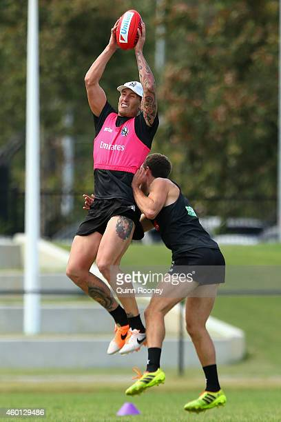 Jesse White of the Magpies marks during a Collingwood AFL preseason training session at Westpac Centre on December 8 2014 in Melbourne Australia