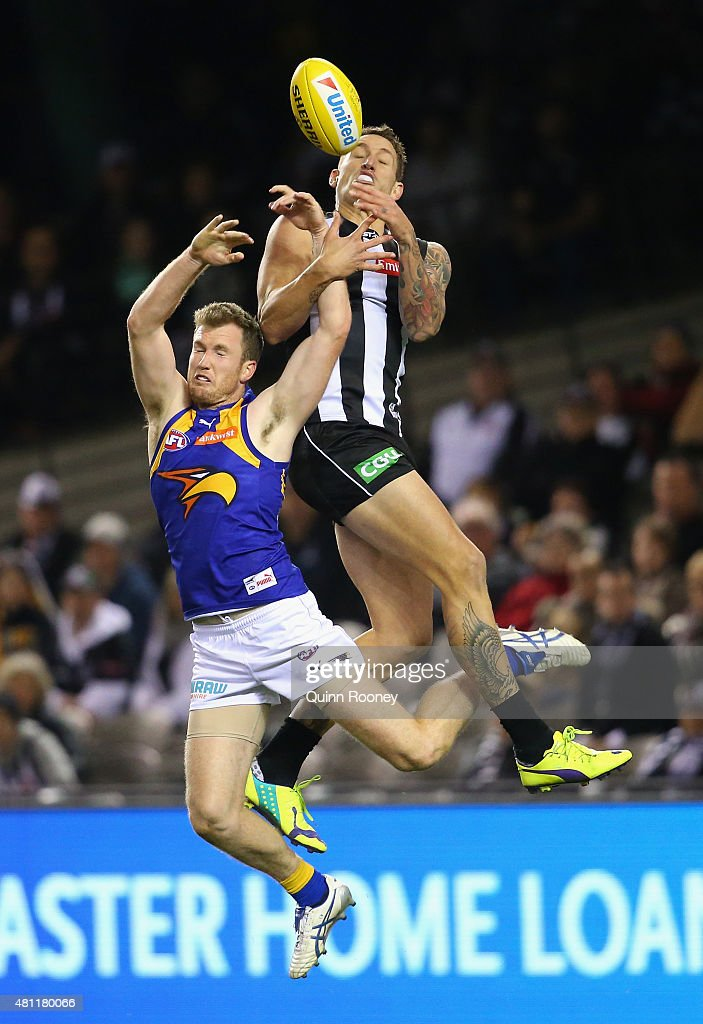 Jesse White of the Magpies marks over the top of Xavier Ellis of the Eagles during the round 16 AFL match between the Collingwood Magpies and the West Coast Eagles at Etihad Stadium on July 18, 2015 in Melbourne, Australia.