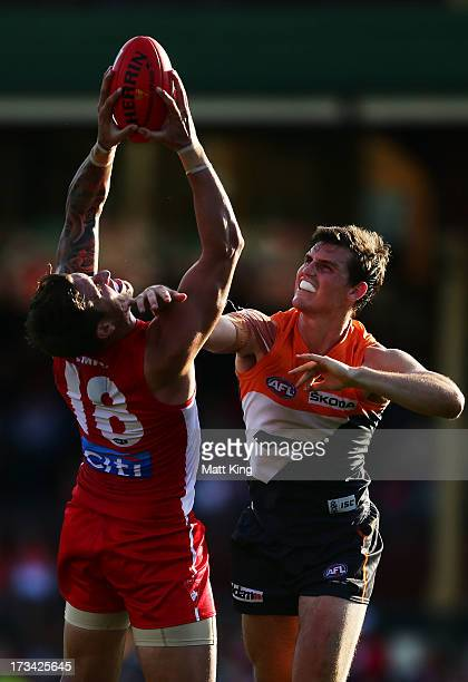 Jesse White of the Swans mark in front of Phil Davis of the Giants during the round 16 AFL match between the Sydney Swans and the Greater Western...