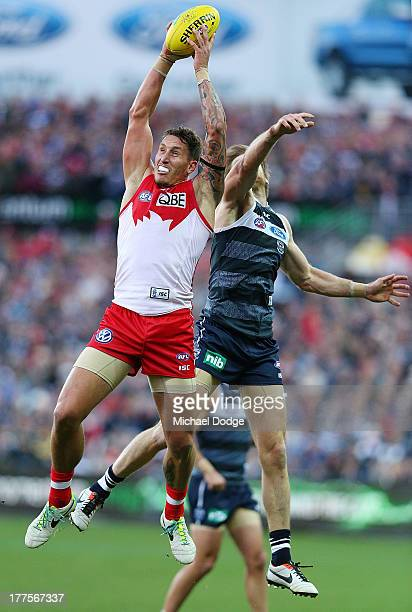 Jesse White of the Swans marks the ball against Tom Lonergan of the Cats during the round 22 AFL match between the Geelong Cats and the Sydney Swans...