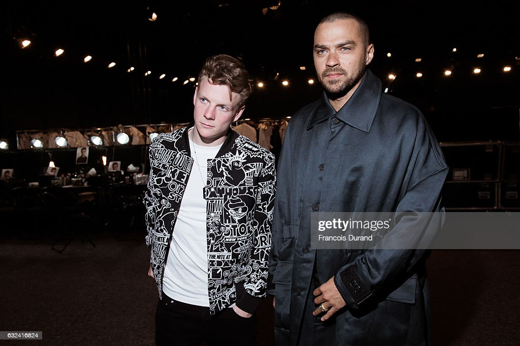 Jesse Williams and Patrick Gibson attend the Kenzo Menswear Fall/Winter 2017-2018 show as part of Paris Fashion Week on January 22, 2017 in Paris, France.