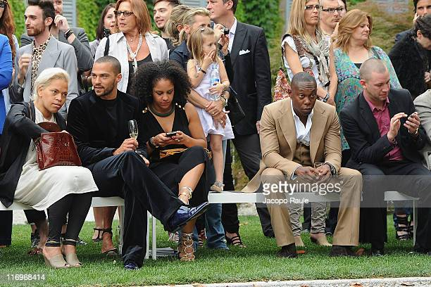 Jesse Williams, Aryn Drake-Lee and Dizzee Rascal attend the Roberto Cavalli fashion show as part of Milan Fashion Week Menswear Spring/Summer 2012 on...