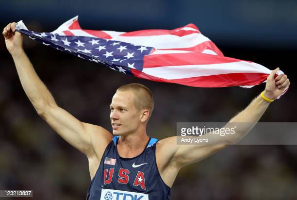 Jesse Williams of United States celebrates with his country's flag after claiming gold in the men's high jump final during day six of the 13th IAAF...