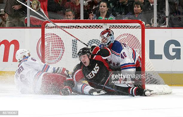 Jesse Winchester of the Ottawa Senators celebrates his second period goal against Wade Redden and Steve Valiquette of the New York Rangers at...
