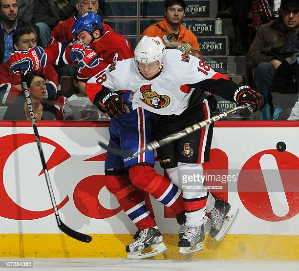 Jesse Winchester of the Ottawa Senators checks Roman Hamrlik of the Montreal Canadiens during the NHL game on December 7 2010 at the Bell Centre in...