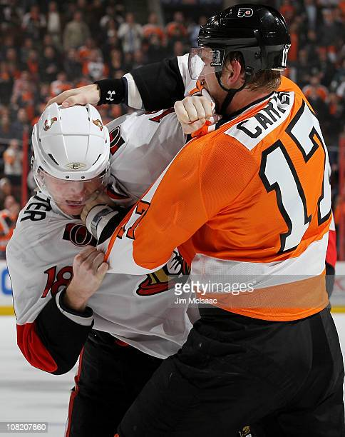 Jesse Winchester of the Ottawa Senators squares off with Jeff Carter of the Philadelphia Flyers during the third period on January 20 2011 at Wells...
