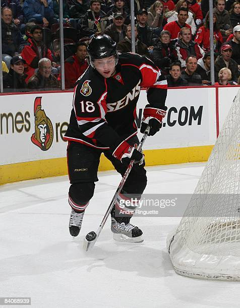 Jesse Winchester of the Ottawa Senators stickhandles the puck against the Pittsburgh Penguins at Scotiabank Place on December 6, 2008 in Ottawa,...