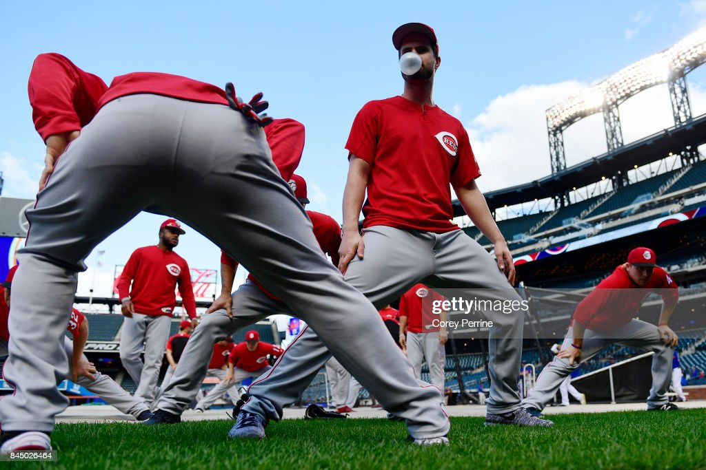 Jesse Winker #33 of the Cincinnati Reds blows a bubble while stretching out before taking on the New York Mets at Citi Field on September 9, 2017 in the Flushing neighborhood of the Queens borough of New York City.