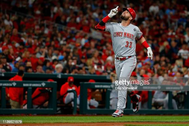 Jesse Winker of the Cincinnati Reds celebrates after hitting a home run against the St. Louis Cardinals in the fourth inning at Busch Stadium on...