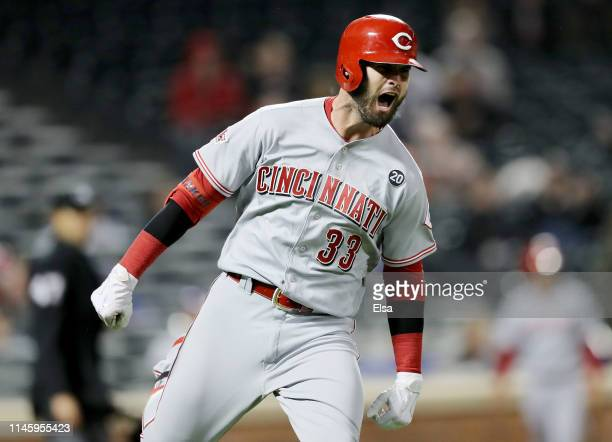 Jesse Winker of the Cincinnati Reds celebrates his game winning home run in the ninth inning against the New York Mets at Citi Field on April 29 2019...