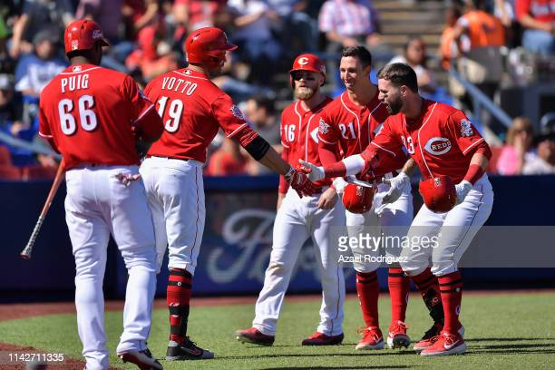 Jesse Winker of the Cincinnati Reds celebrates with teammates after hitting a home run in the sixth inning of the second game of the Mexico Series...