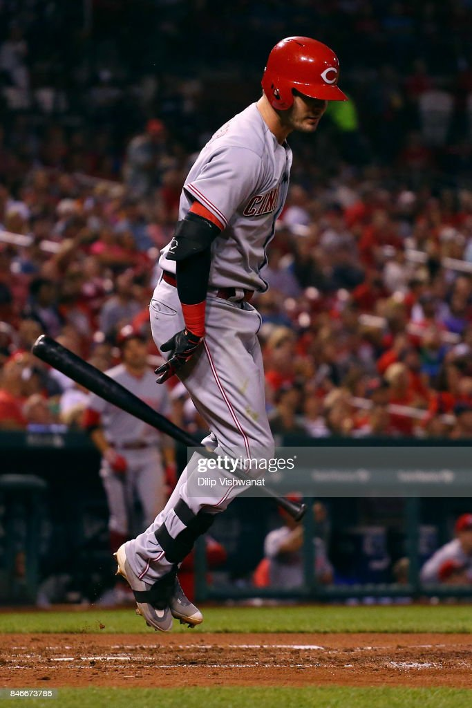 Jesse Winker #33 of the Cincinnati Reds flips his bat in frustration after popping out against the St. Louis Cardinals in the fifth inning at Busch Stadium on September 13, 2017 in St. Louis, Missouri.