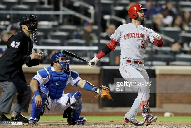 Jesse Winker of the Cincinnati Reds hits the game winning home run in the ninth inning as Wilson Ramos of the New York Mets defends at Citi Field on...