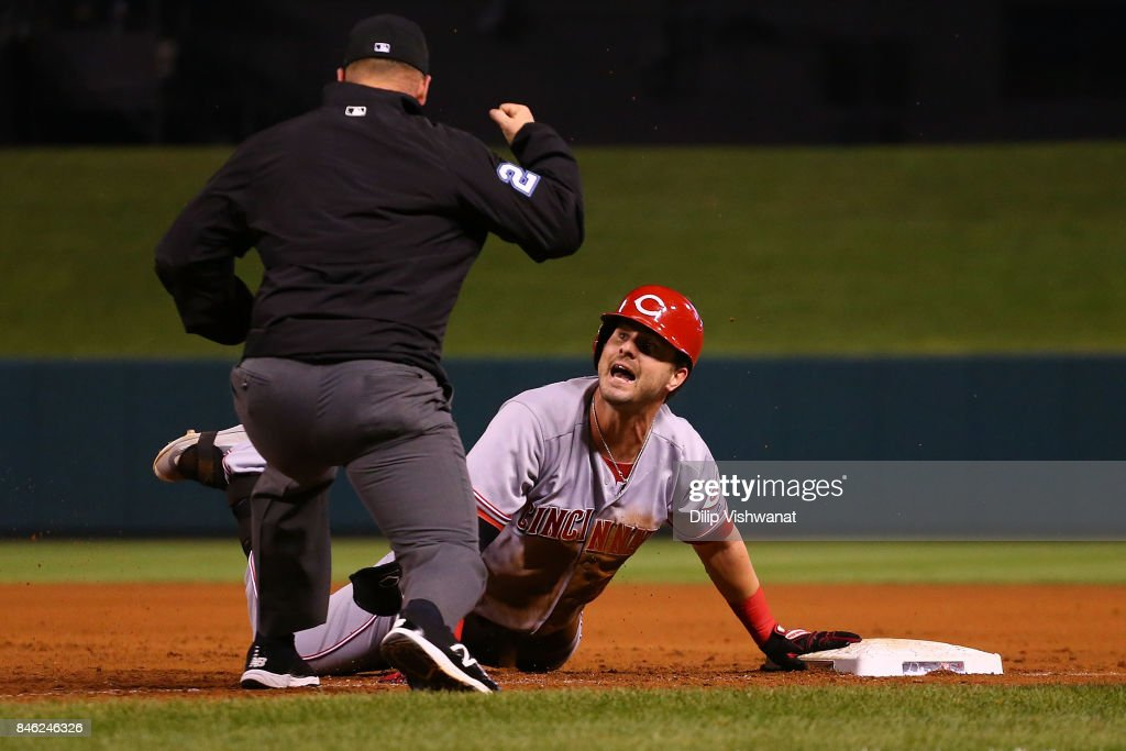 Jesse Winker #33 of the Cincinnati Reds reacts after being tagged out at first base after getting caught in a run down against the St. Louis Cardinals in the fifth inning at Busch Stadium on September 12, 2017 in St. Louis, Missouri.