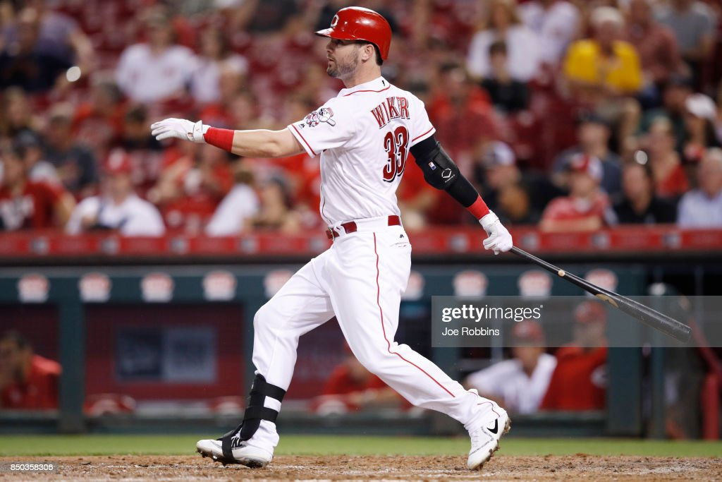 Jesse Winker #33 of the Cincinnati Reds singles to drive in a run in the fifth inning of a game against the St. Louis Cardinals at Great American Ball Park on September 20, 2017 in Cincinnati, Ohio. The Cardinals won 9-2.