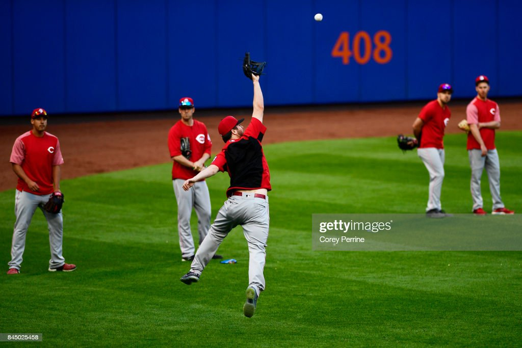 Jesse Winker #33 of the Cincinnati Reds snags a line drive in left field before taking on the New York Mets at Citi Field on September 9, 2017 in the Flushing neighborhood of the Queens borough of New York City.