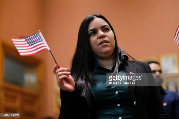 Jessenia Checo a candidate for US citizenship takes the oath of allegiance during a Naturalization Ceremony for new US citizens at the City Hall of...
