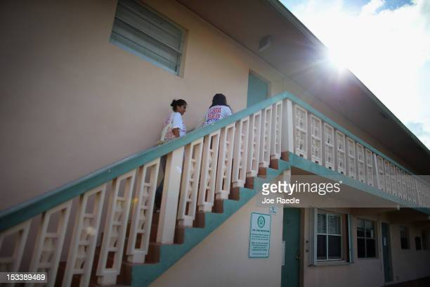 Jessenia Fernandez and Karen Garcia go door to door in an apartment complex as they look for people that have not registered to vote during a voter...