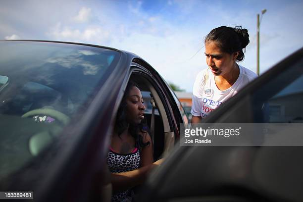 Jessenia Fernandez takes down Carline Etienne's information as she signs her up to vote during a voter registration drive by members of the Florida...