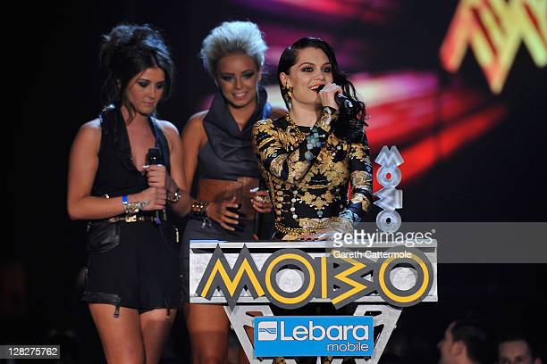 Jessi J accepts the award for Best Song as Brooke Vincent and Sasha Parkinson look on during the MOBO Awards 2011 at the SECC on October 5 2011 in...
