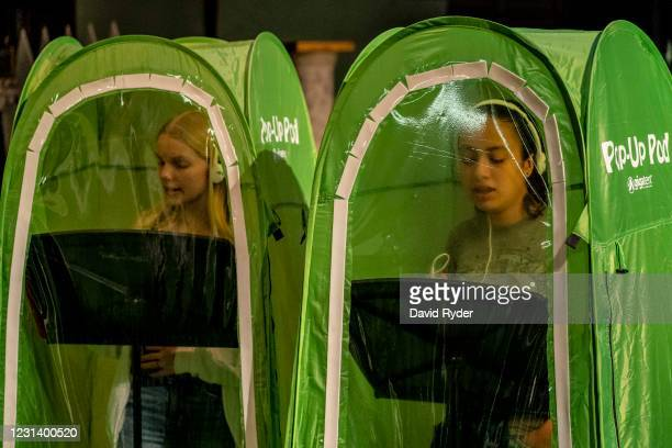 Jessi McIrvin and Valerie Sanchez record vocals in pop-up tents during choir class at Wenatchee High School on February 26, 2021 in Wenatchee,...