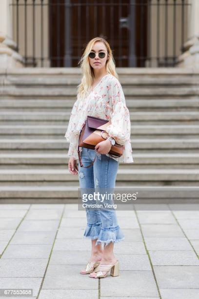 Jessi Quednau wearing a blouse with floral print from Chicwish cropped denim jeans Storets a brown Chloe bag golden heeled slippers Dorothy Perkins...