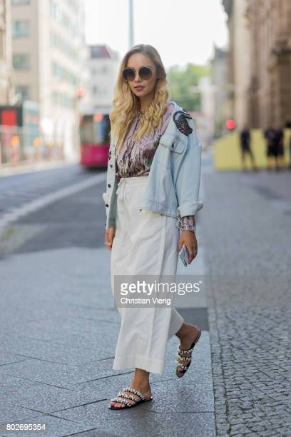 Jessi Quednau wearing a Marc Jacobs denim jacket sandals Zara pastel blouse Zara white wide leg pants Monki on June 28 2017 in Berlin Germany