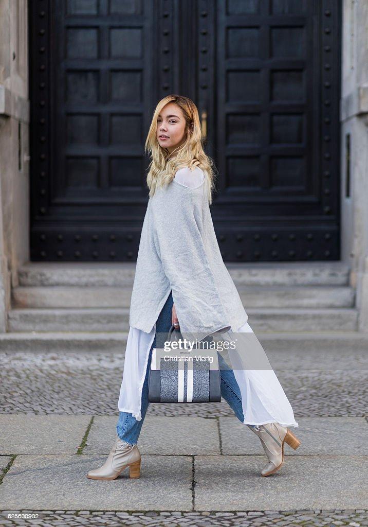 Jessi Quednau (@fashionzire) wearing light grey Buffalo boots, blue Levis denim jeans, grey poncho Zara, white blouse Zara, a grey white Steve Madden bag on November 24, 2016 in Berlin, Germany.