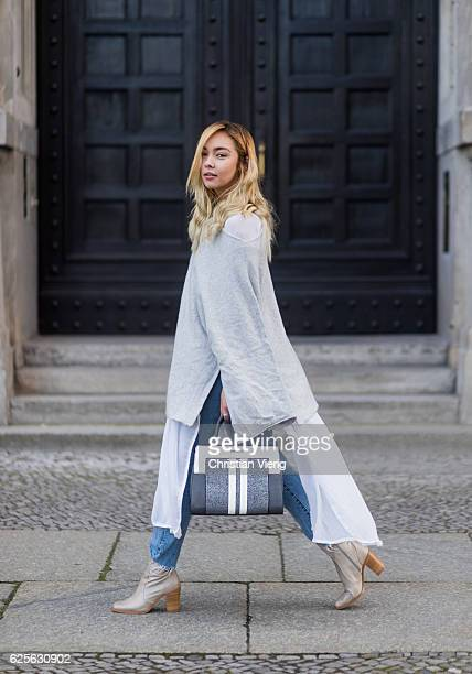 Jessi Quednau wearing light grey Buffalo boots blue Levis denim jeans grey poncho Zara white blouse Zara a grey white Steve Madden bag on November 24...