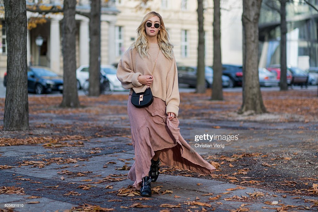 Jessi Quednau (@fashionzire) wearing Rayban round sunglasses, pastel light orange H&M knit jumper sweater, a pastel red dress Asos, black ankle boots Topshop, black Chloe bag on November 24, 2016 in Berlin, Germany.