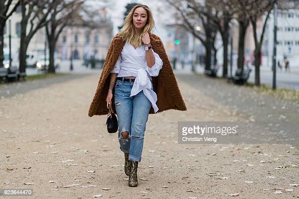 Jessi Quednau wearing white blouse Storets ripped denim jeans Levi0 golden heeled chelsea boots Topshop a brown teddy coat Paisie via Asos a black...