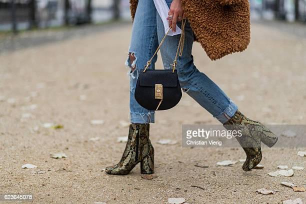 Jessi Quednau wearing white blouse Storets ripped denim jeans Levi0 golden heeled chelsea boots Topshop a brown teddy coat Paisie via Asos a black...