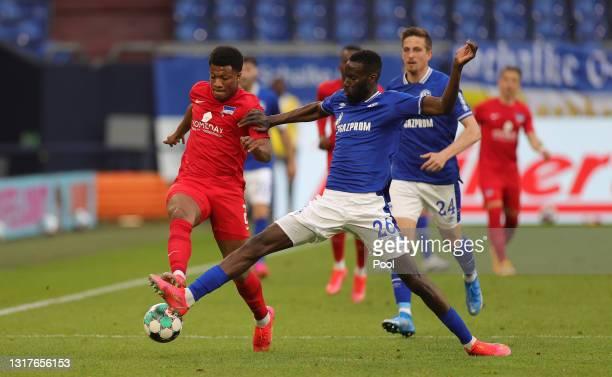 Jessic Ngankam of Hertha BSC battles for possession with Salif Sane of FC Schalke 04 during the Bundesliga match between FC Schalke 04 and Hertha BSC...