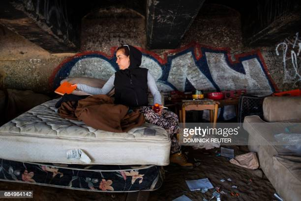 Jessica a homeless heroin addict arranges some belongings around the spot under the bridge where she lives in the Kensington neighborhood of...